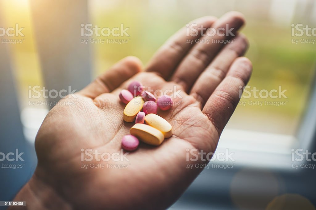 vitamins in my hand stock photo