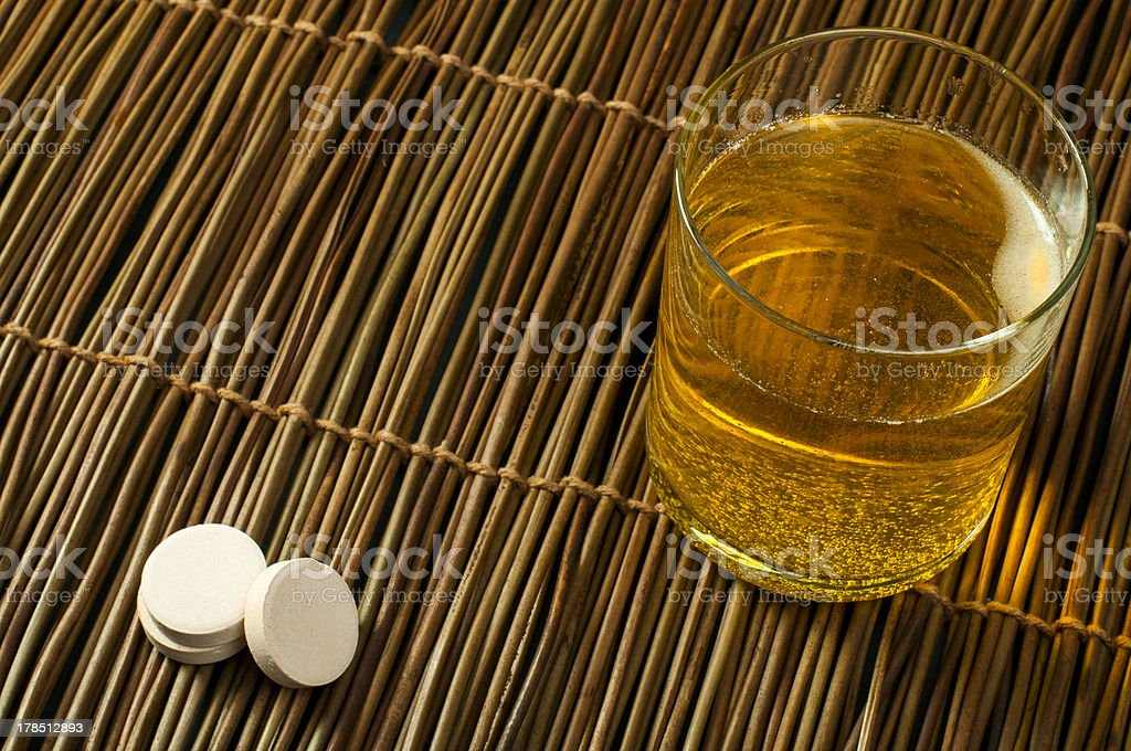 Vitamins pills soluble in water royalty-free stock photo