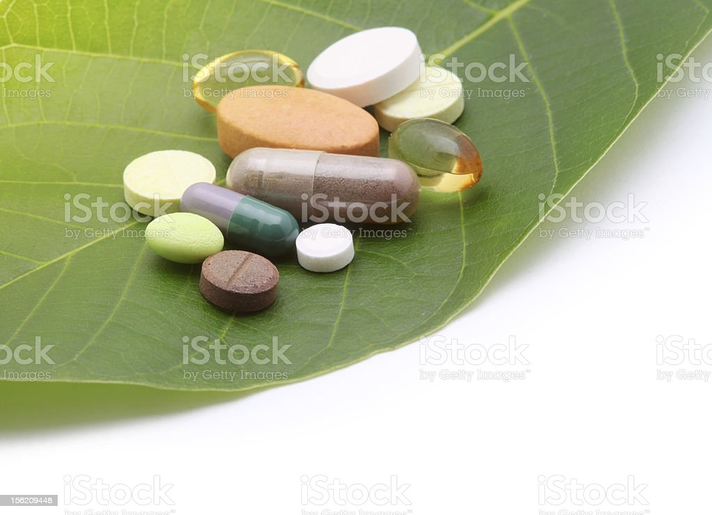 vitamins, tablets, pill and green leaf stock photo