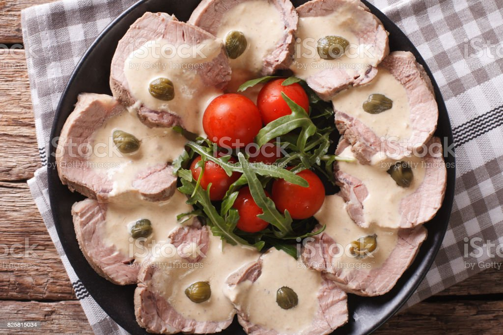 Vitello tonnato with capers close-up. Horizontal top view stock photo