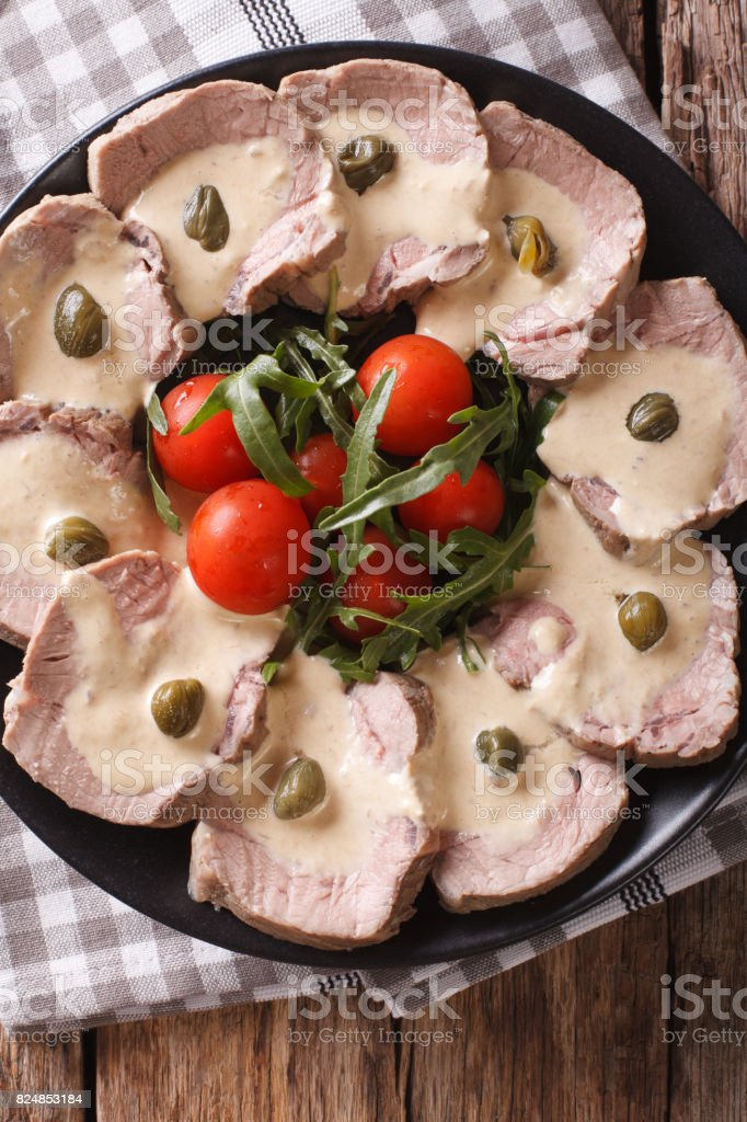 Vitello tonnato with capers close-up. Vertical top view stock photo