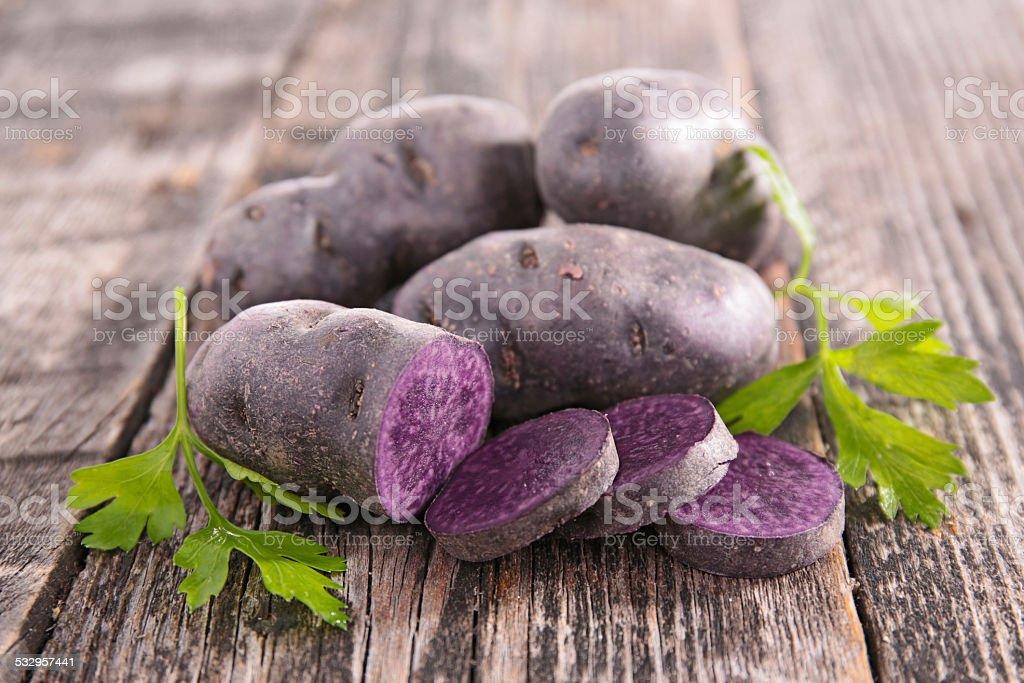 vitelotte, raw potato stock photo