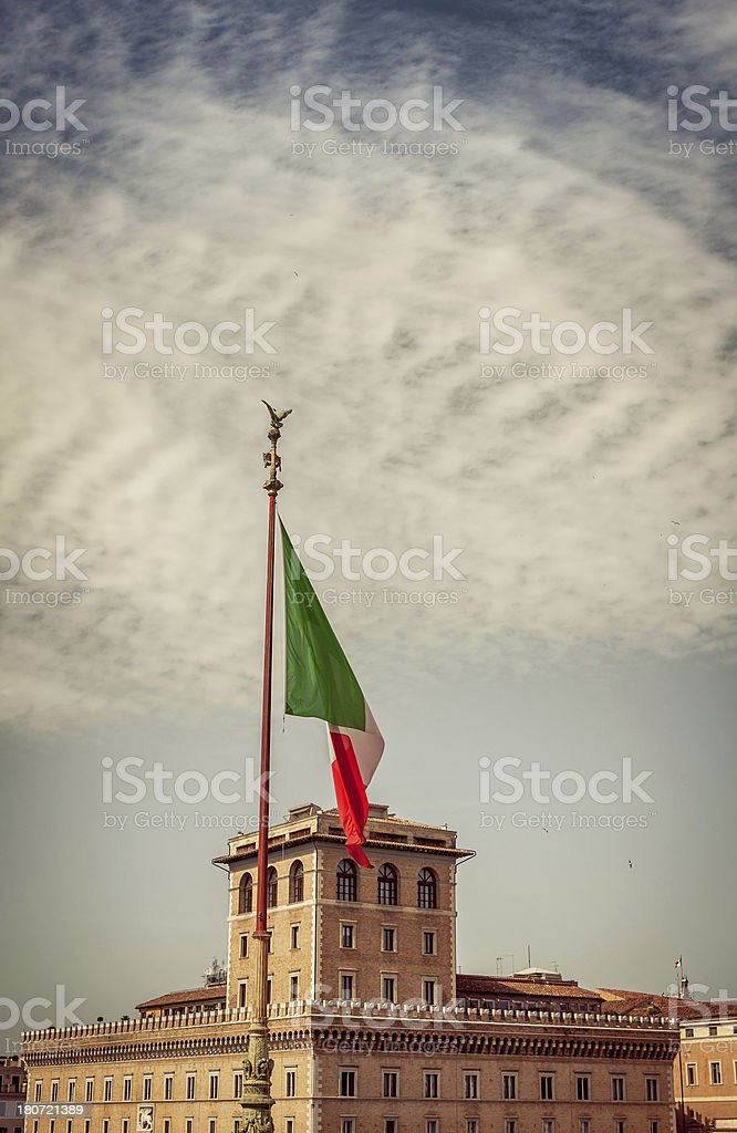 Vittorio Emanuele Monument in Rome and Italian Flag royalty-free stock photo