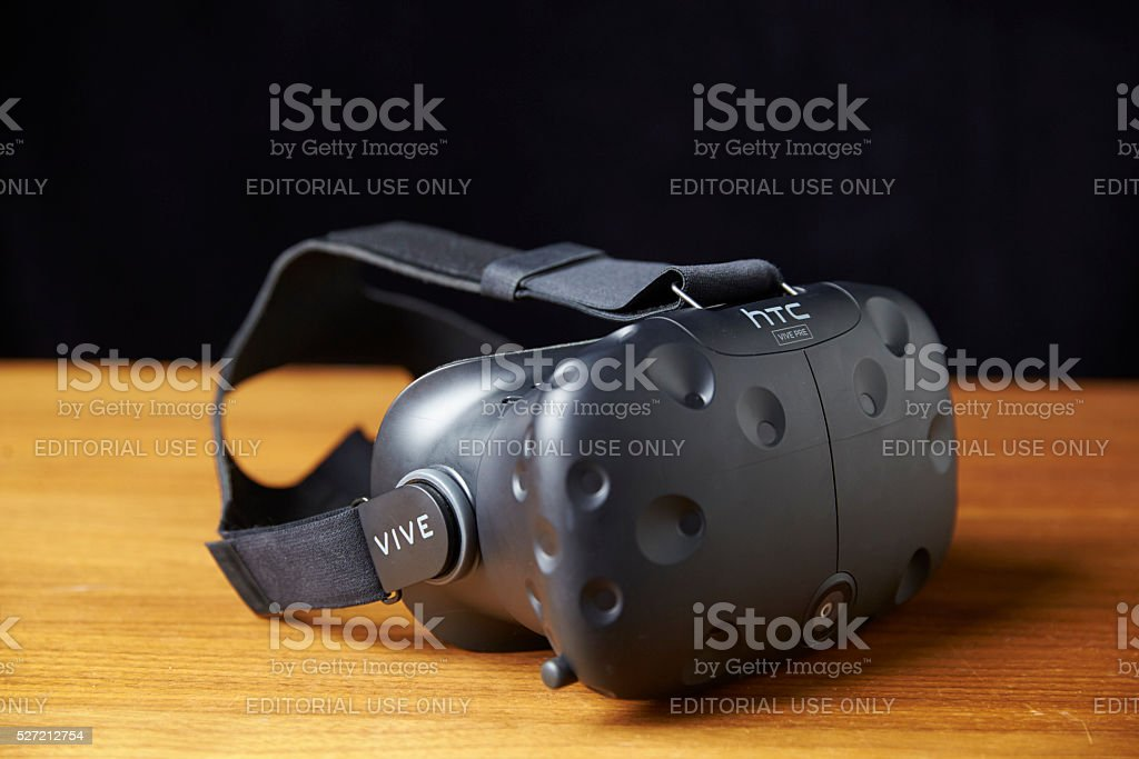 HTC Vive Virtual Reality Headset On Wooden Background stock photo