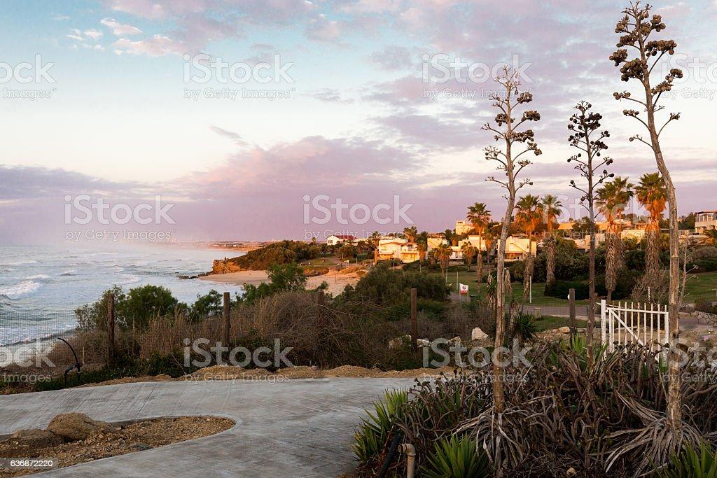 Vivid colorful evening sunset sea shore village town view. stock photo