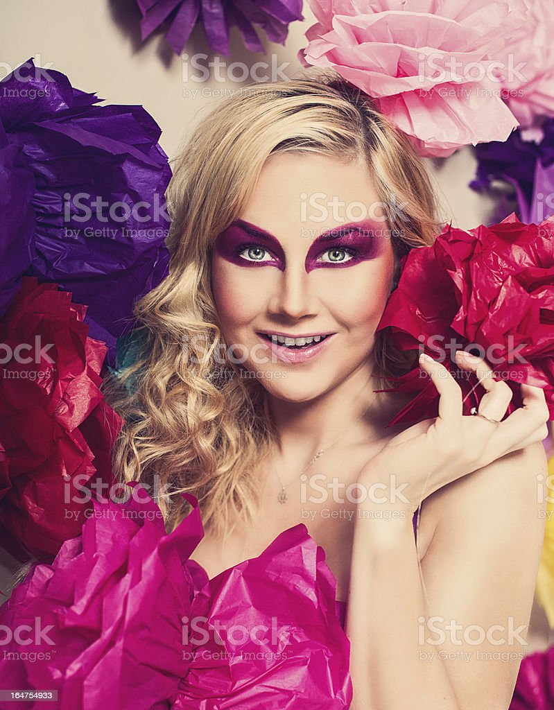Vivid portrait of woman and pom poms royalty-free stock photo