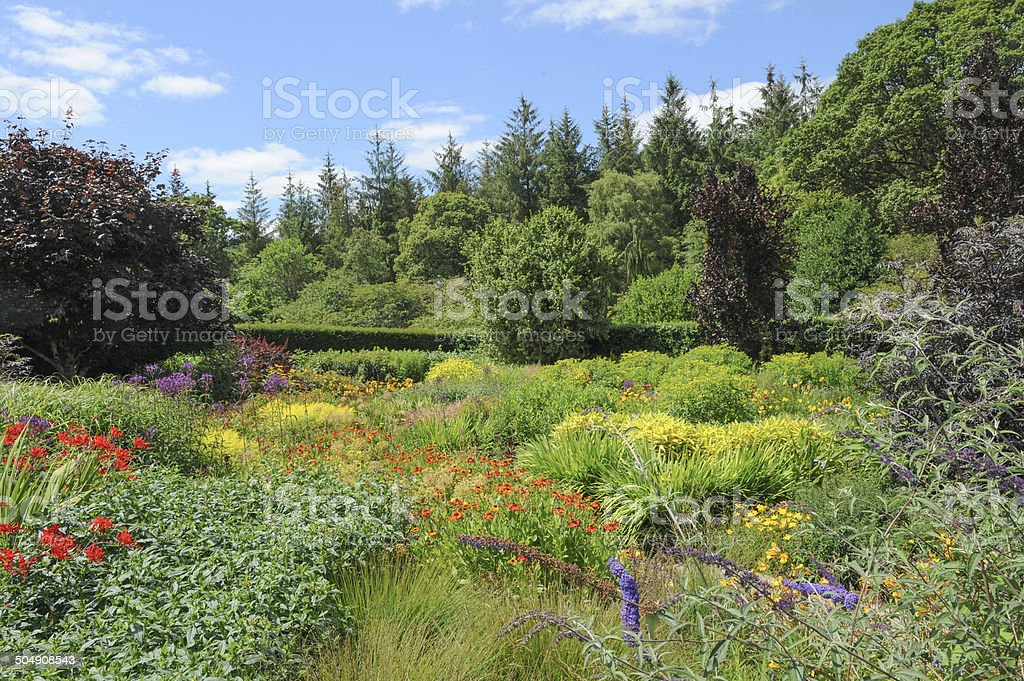 Vivid, vibrant coloured flowerbed in a traditional garden in Devon. stock photo