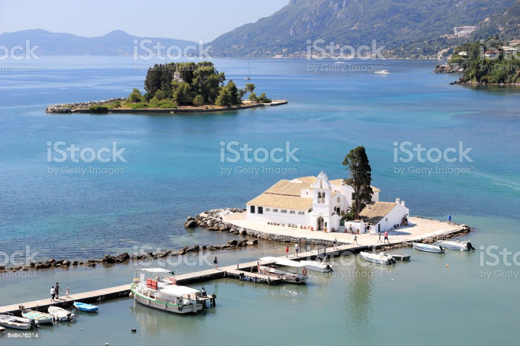 Vlacherna Monastery (foreground) and Pontikonisi (background) seen from the hilltops of Kanoni. Corfu island, Ionian Sea, Greece. stock photo