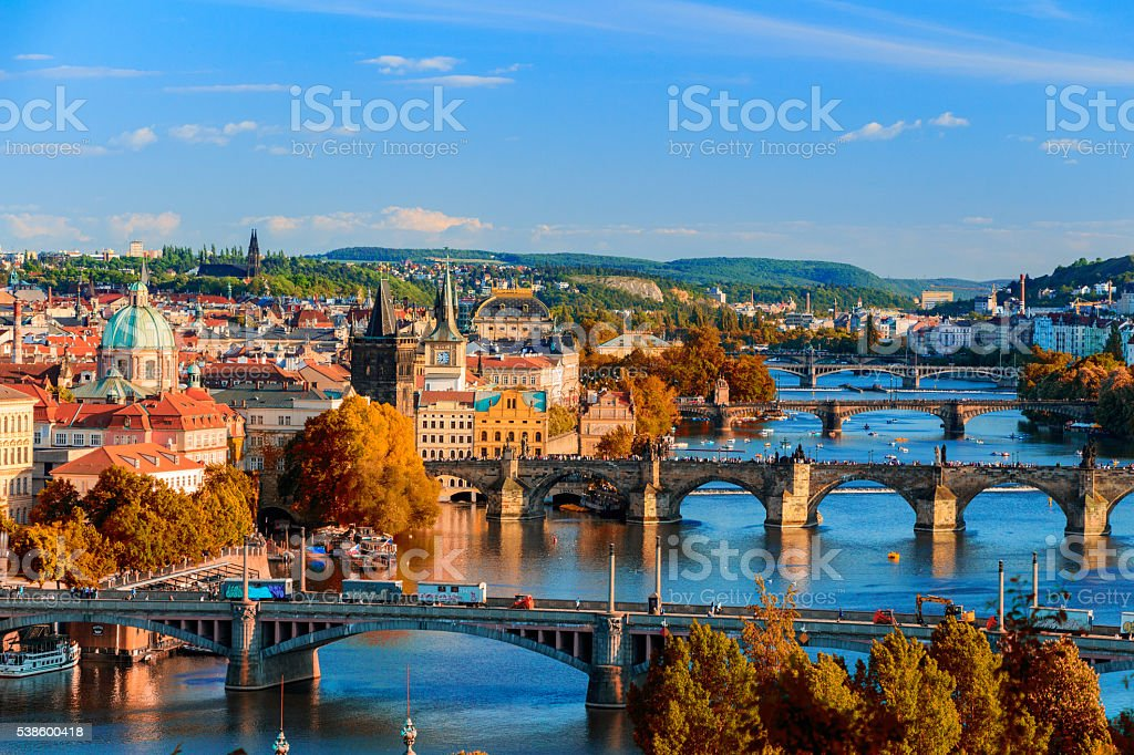 Vltava River and Charle bridge with red foliage stock photo