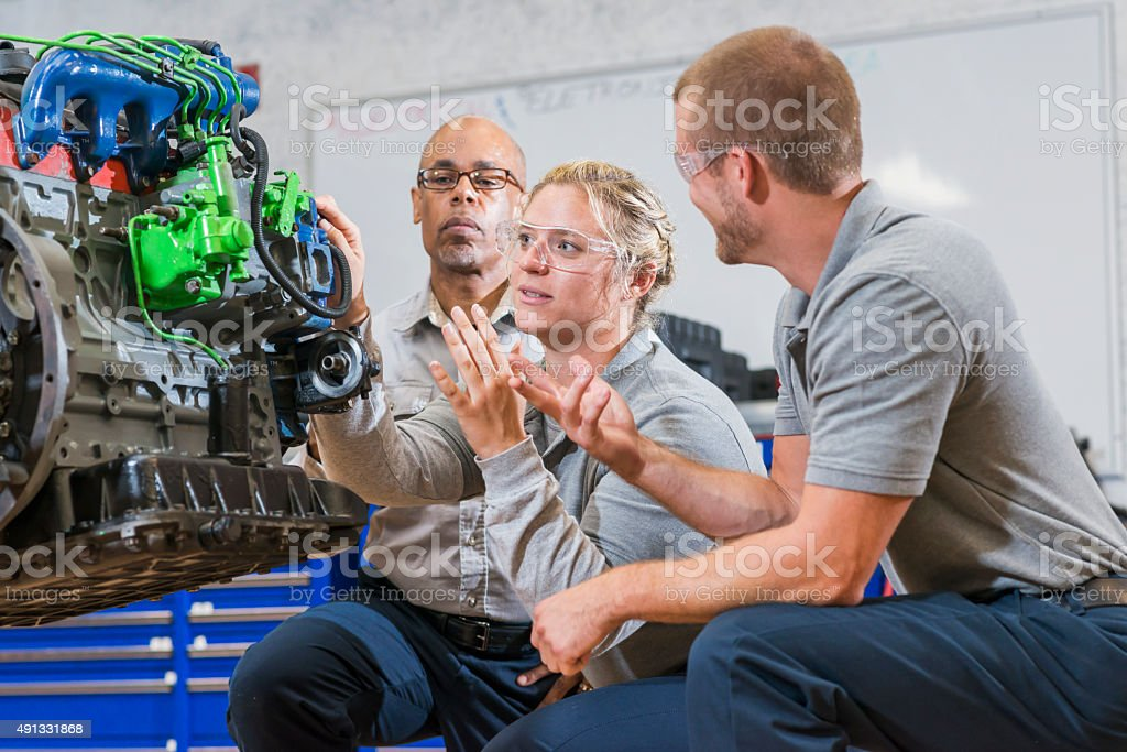 Vocational class, learning to repair diesel engine stock photo