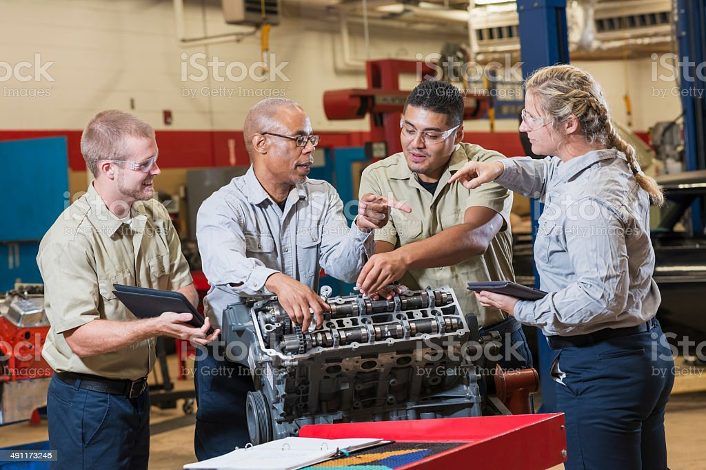 Vocational class, learning to repair gasoline engine stock photo