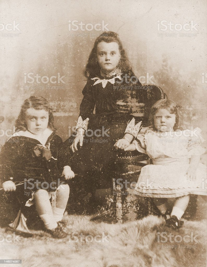 Voctorian Portrait of 3 young girl sisters stock photo