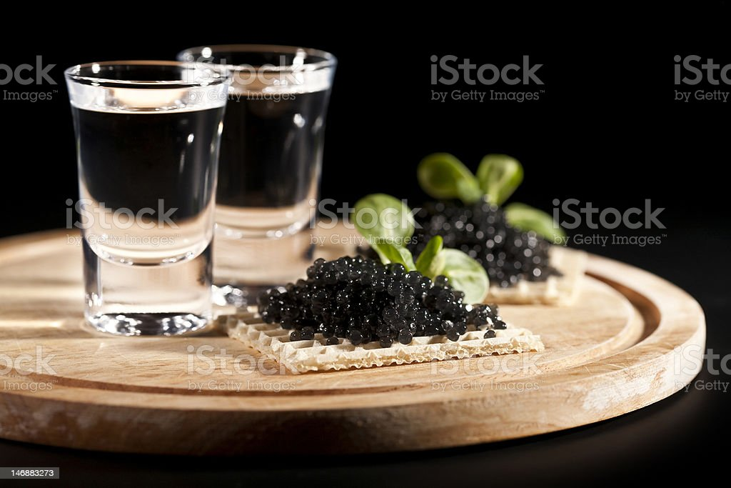 vodka and sandwiches with black caviar stock photo