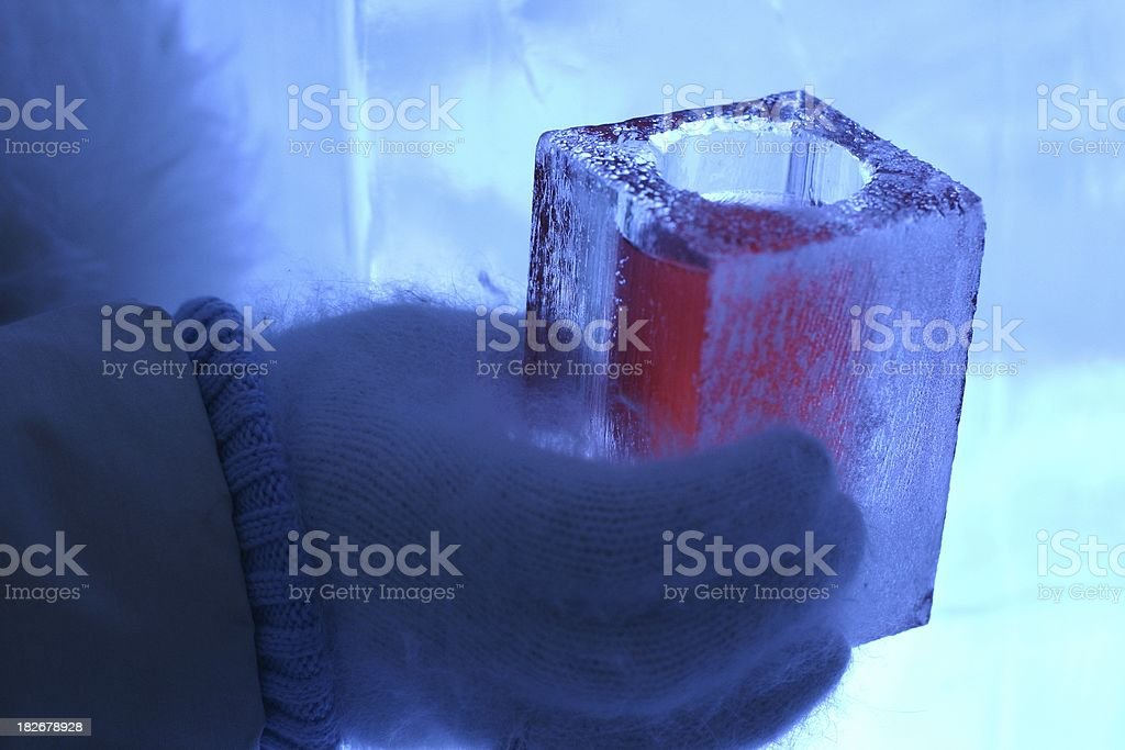 vodka cocktail served in a glass made of ice stock photo