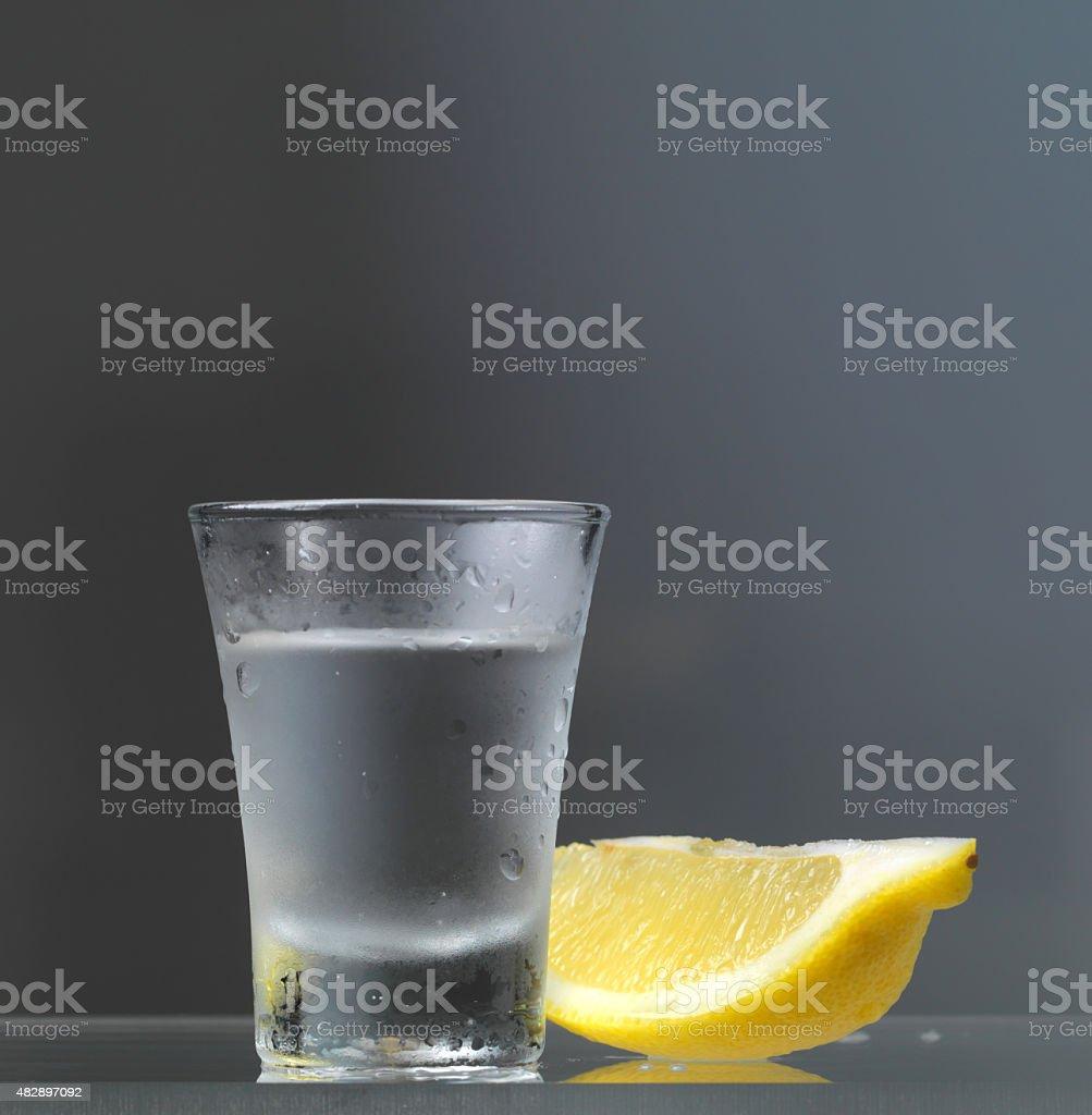vodka glass with lemon slice stock photo