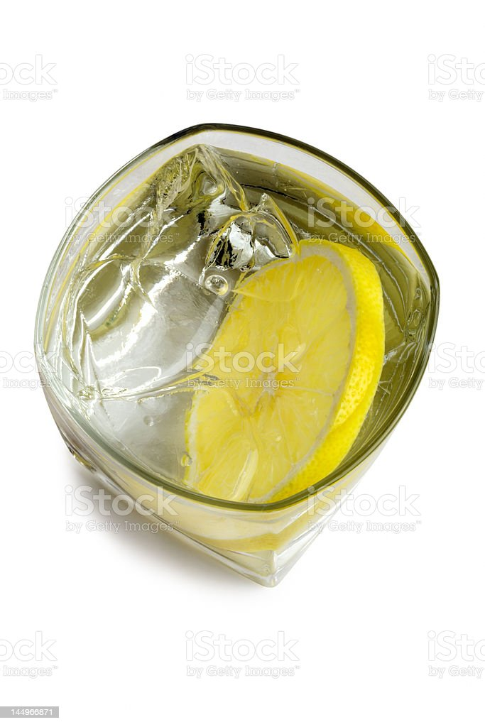 Vodka on the rocks with lemon royalty-free stock photo