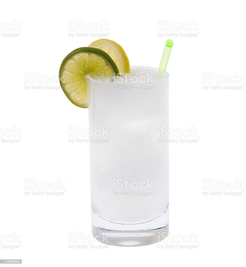 A vodka or gin tonic cocktail against a white background royalty-free stock photo