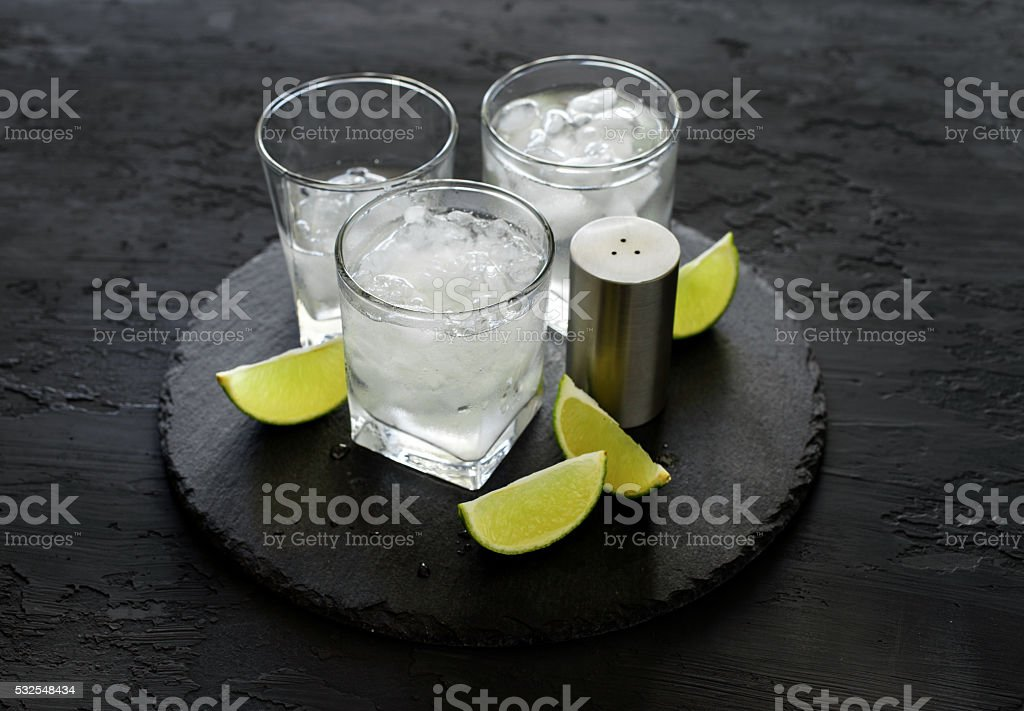 Vodka or gin with ice and lime stock photo