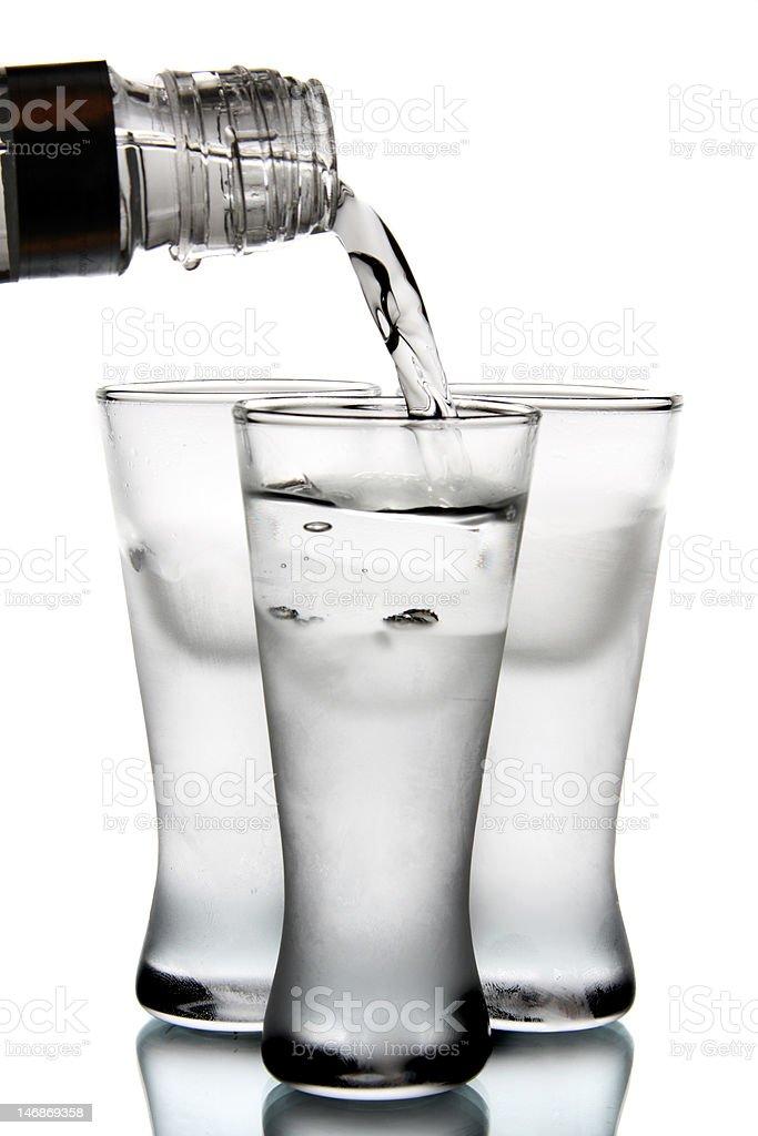 Vodka pour into glass royalty-free stock photo