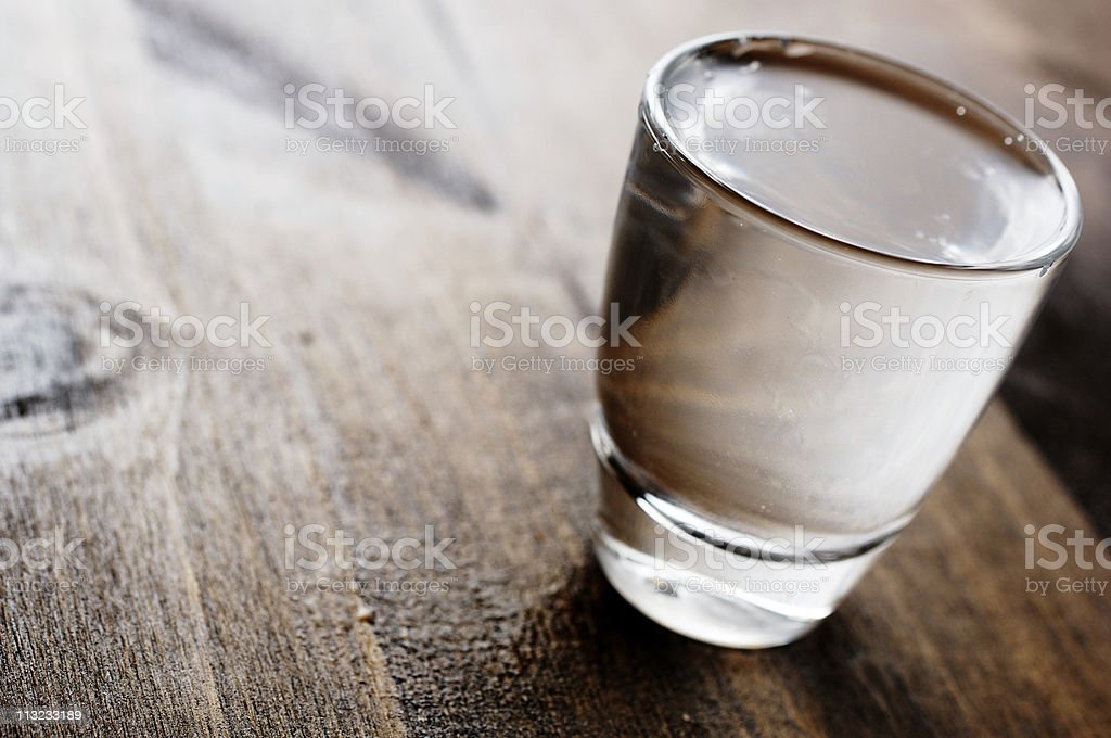vodka shot glass back lit stock photo