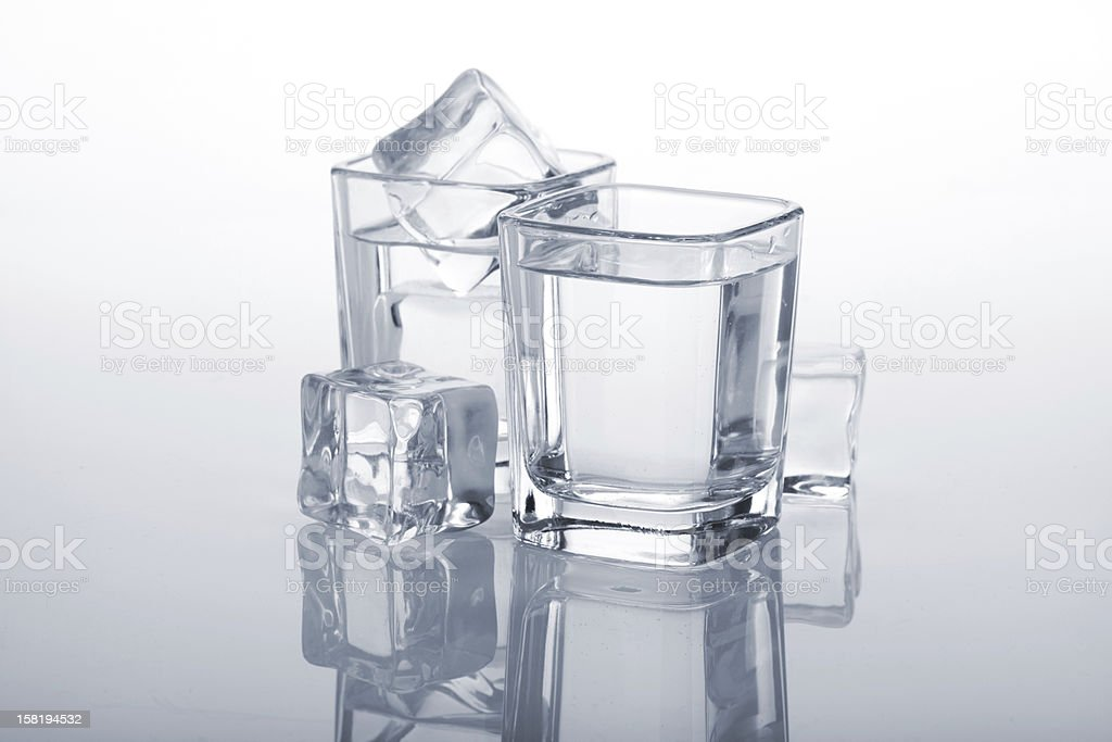 Vodka shots with ice cubes royalty-free stock photo