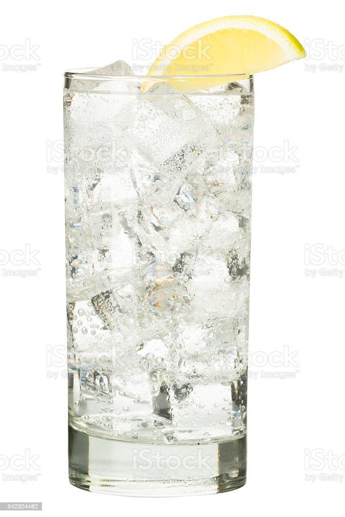 Vodka tonic sparkling water with lemon on white stock photo