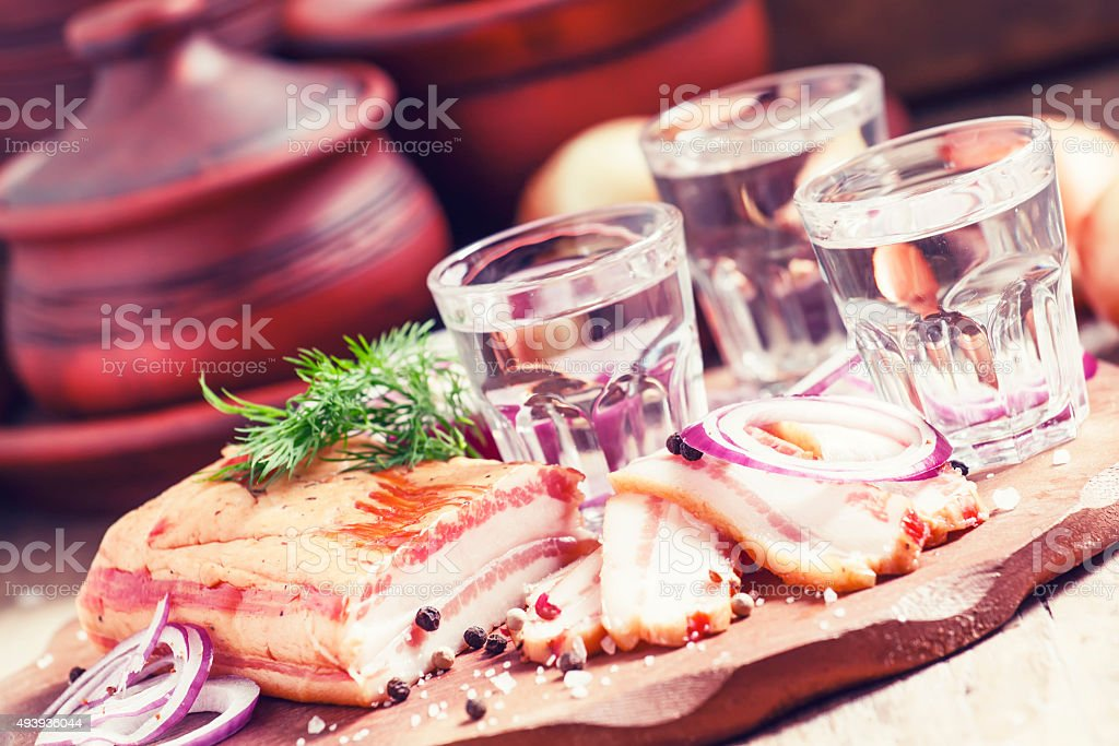 Vodka with spicy red onion, bacon and pepper stock photo