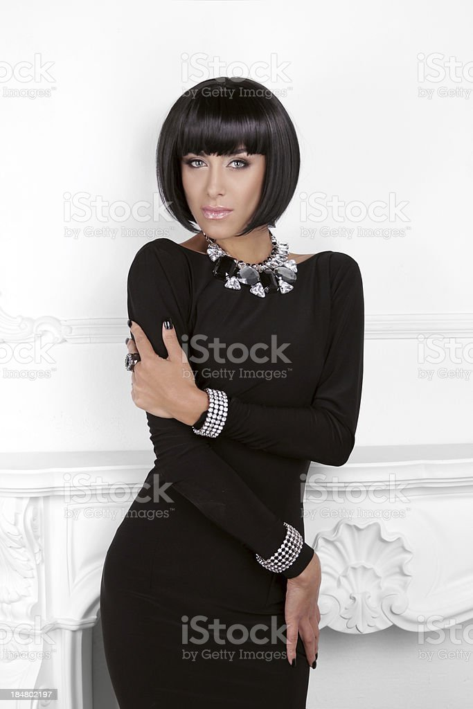 Vogue Style. Fashion Beauty Woman in sexy black dress. Brunette royalty-free stock photo