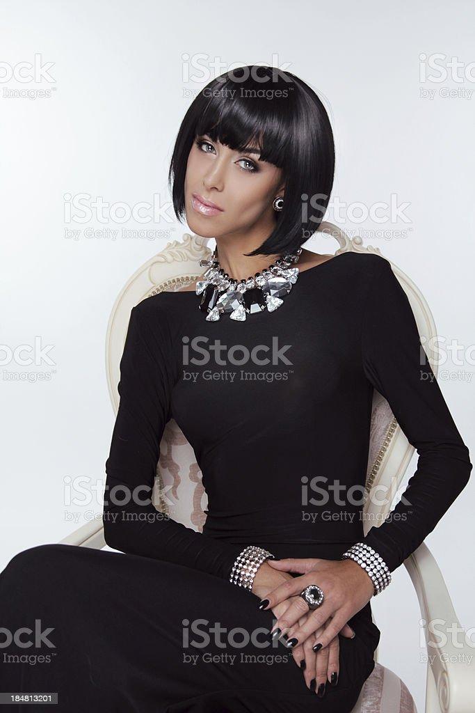 Vogue Style. Fashion Elegant Woman in  black dress. Brunette royalty-free stock photo