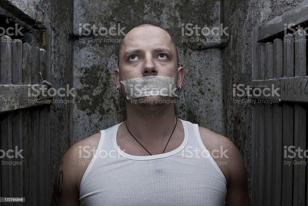 Voiceless prisoner stock photo