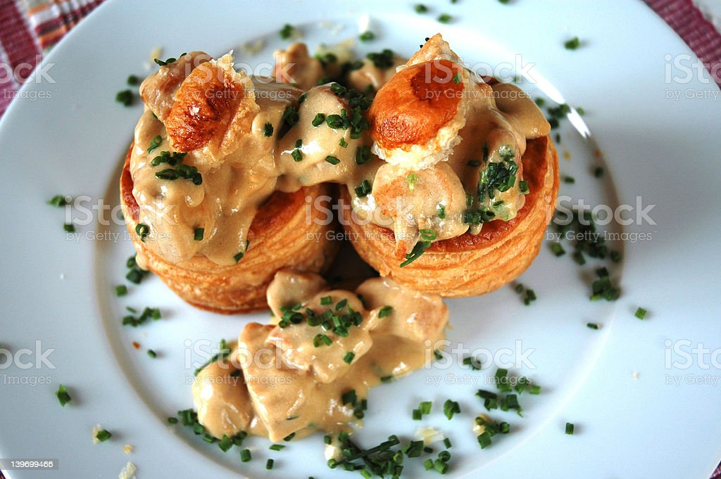 Vol au vent stuffed with chicken and creamy sauce (French specia stock photo
