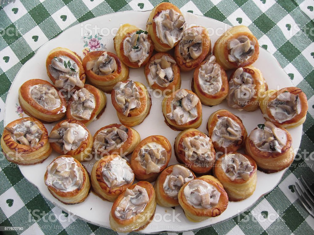 Vol au vents filled with chopped mushrooms and cooking cream stock photo