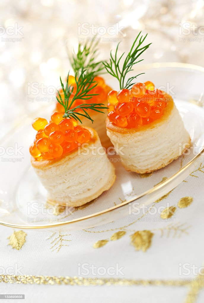 Vol-au-vents filled with red caviar stock photo