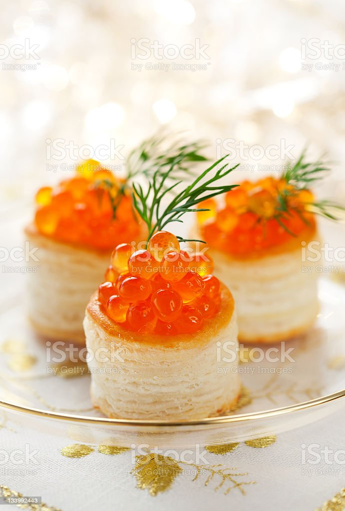 Vol-au-vents filled with red caviar royalty-free stock photo