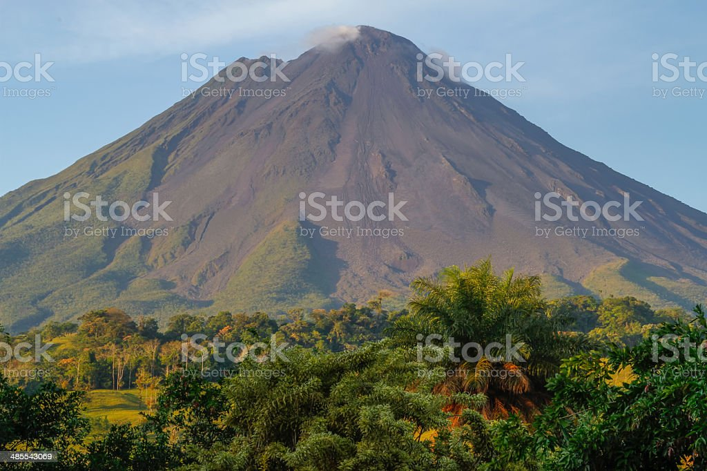 Volcan arenal by sunrise stock photo