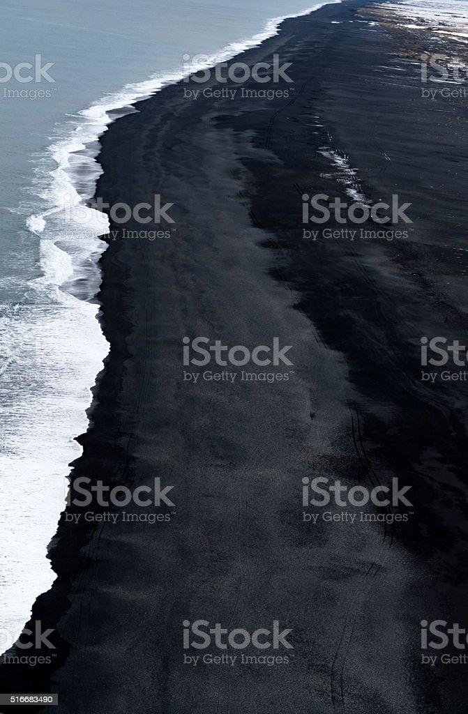 Volcanic black sand beach, view from Dyrholaey,Iceland stock photo