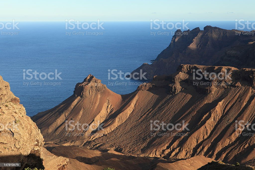 Volcanic coastline of St Helena Island late afternoon stock photo