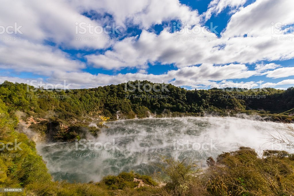 Volcanic crater with steaming lake stock photo