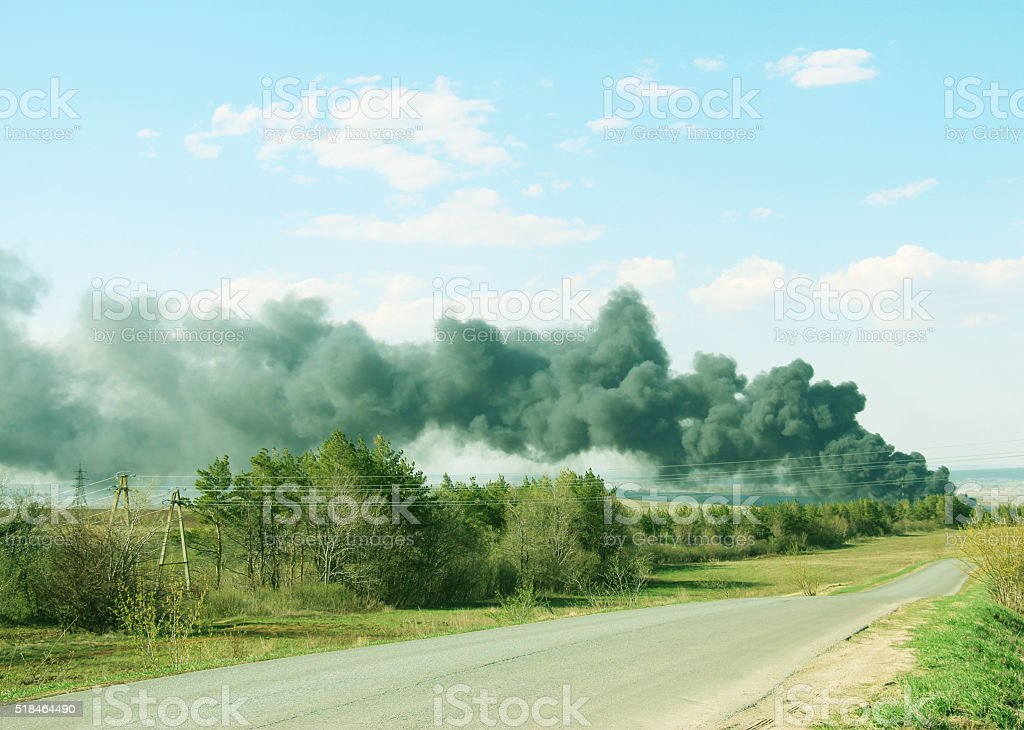 volcanic eruption and black smoke from polluting emissions stock photo