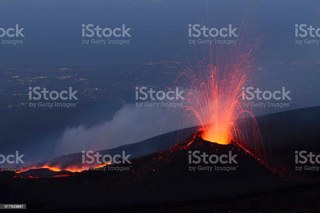 Volcanic eruption at night stock photo