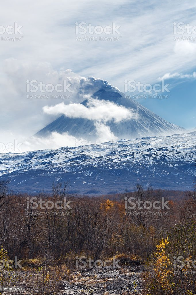 Volcanic eruption: plume of gas, steam, ash from crater stock photo