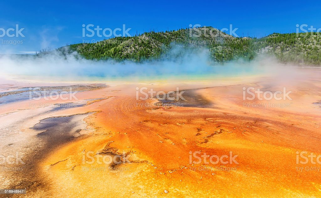 Volcanic hot spring of unusual color, steam. stock photo