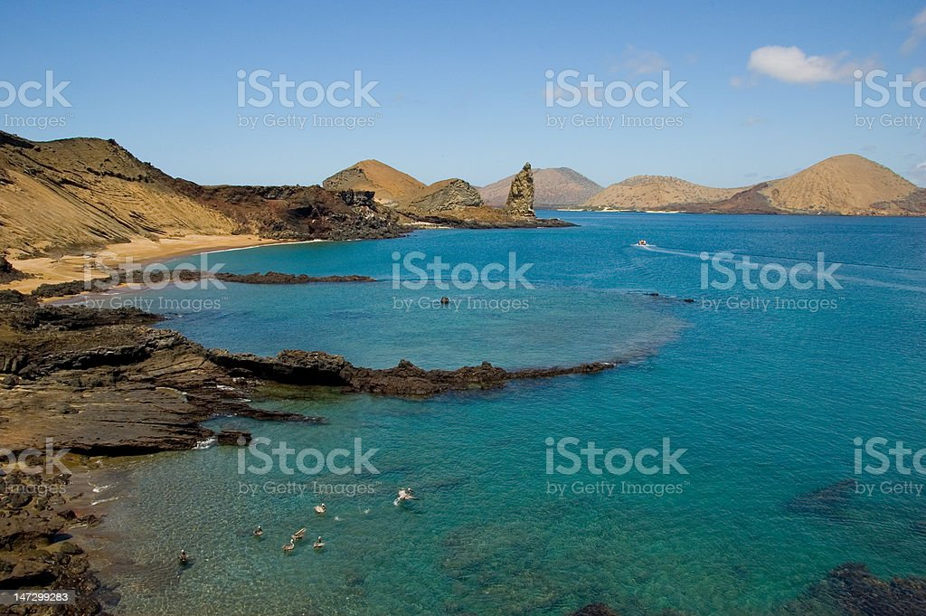 Volcanic island in ocean stock photo