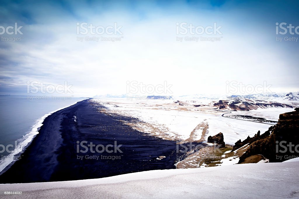 Volcanic landscape with black sand beach near Vik,Dyrholaey,Iceland stock photo