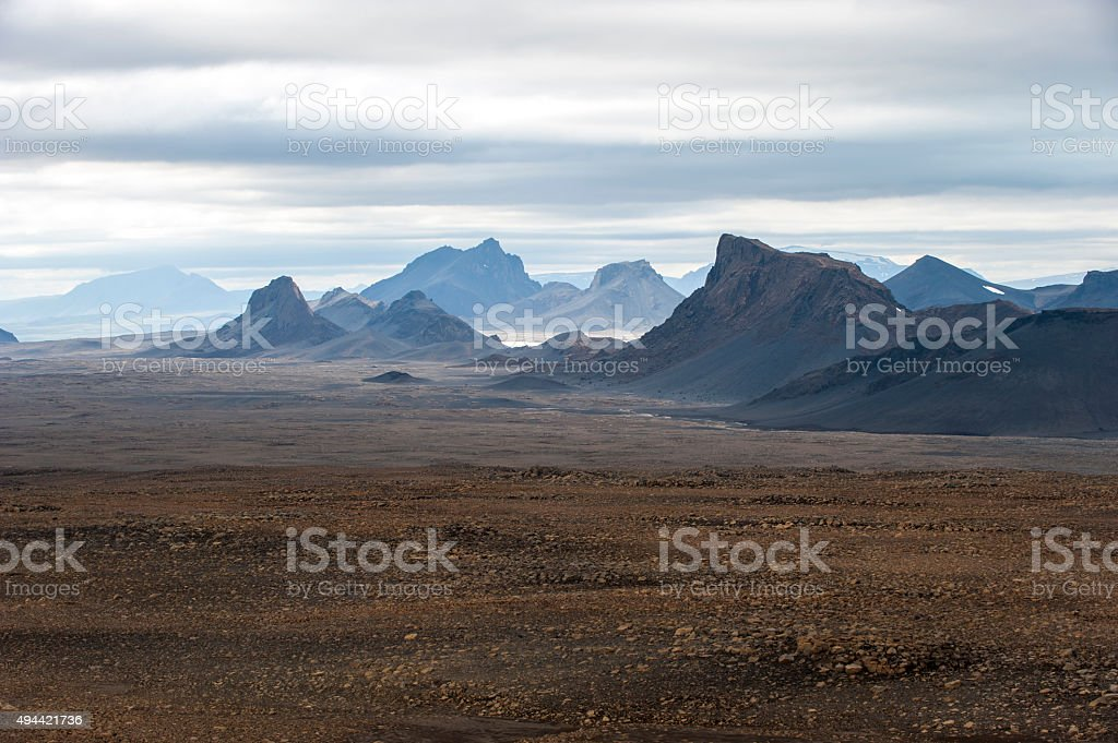 Volcanic landscape with mountains near Langjokull glacier, South Iceland stock photo