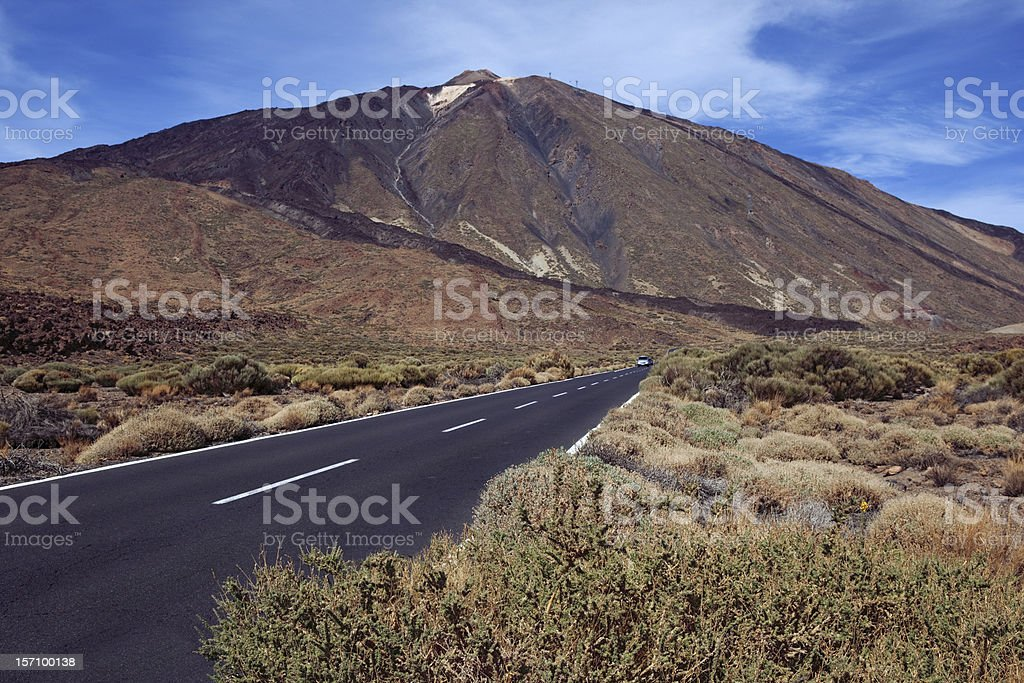 Volcanic landscape with road and traces of lava streams. royalty-free stock photo