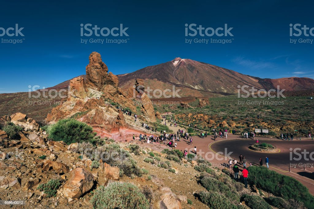 Volcanic landscape with tourists visiting volcano of Teide, Tenerife stock photo