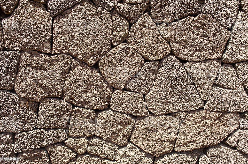 Volcanic masonry wall. stock photo