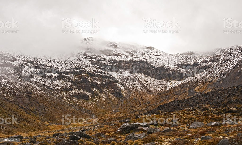Volcanic peak in Spring Snow royalty-free stock photo