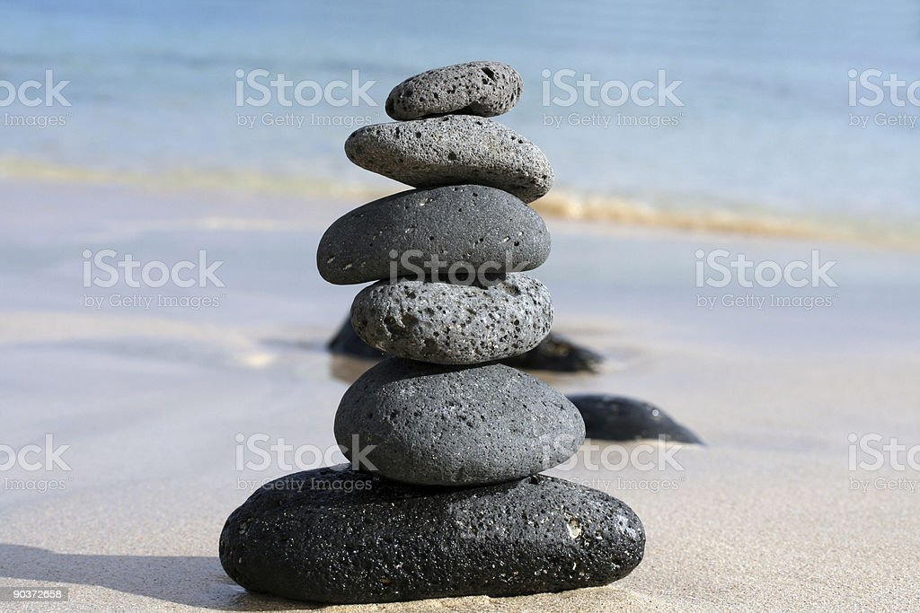 volcanic pebbles in the beach royalty-free stock photo
